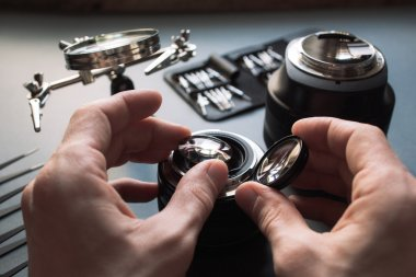 Prime pptical lens service, adjust and align.