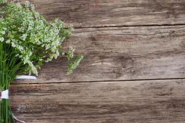 Bunch of flowers on wooden background, copyspace