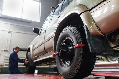 Auto wheel alignment in garage ,SUV maintenance
