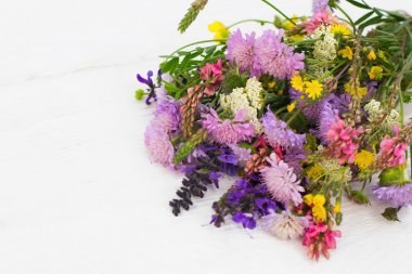 Colorful bouquet of wildflowers, white background