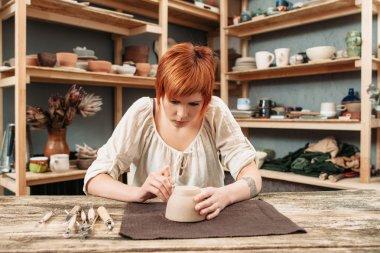 Workshop of craftsman pottery, pot decorating