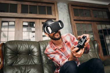 Man playing video games in virtual reality headset