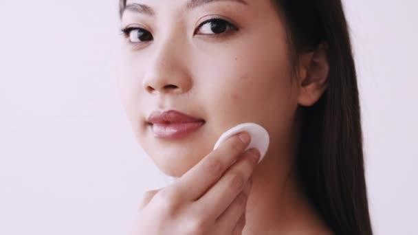 korean facial skincare woman using cotton pad