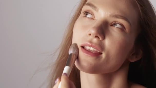 nude makeup natural beauty woman face powder brush