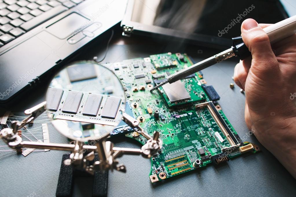 Technician repair (soldering iron) computer (laptop) motherboard ...