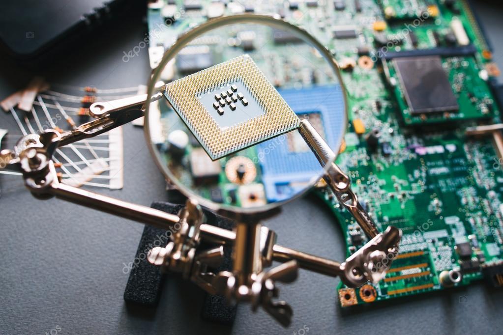 Cpu processor through a magnifying glass.