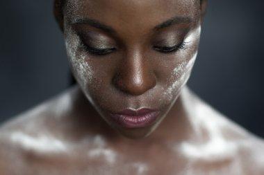 creative makeup. black skin and white powder