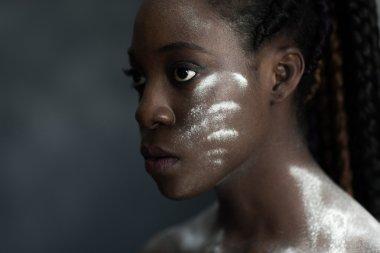black human skin with wite stripes of powder