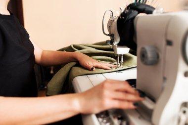 seamstress sews clothes