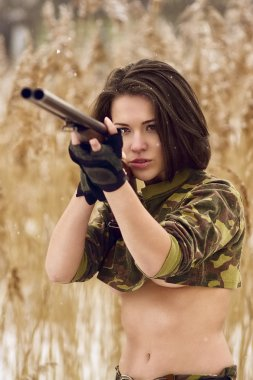 pretty girl aiming with hunting rifle