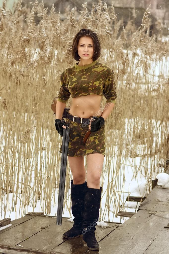 pretty girl holding hunting rifle