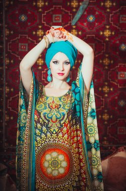 Portrait of a beautiful woman in oriental dress. Grace and beauty.