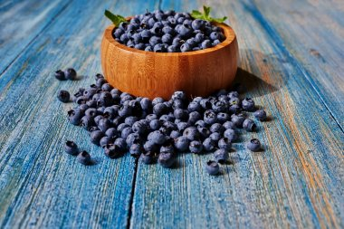 Blueberries on the table in a wooden bowl