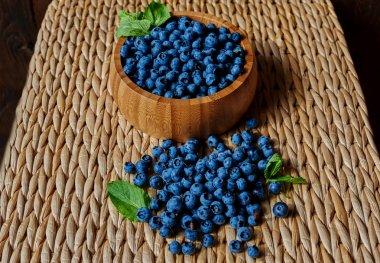 Blueberries on rattan table