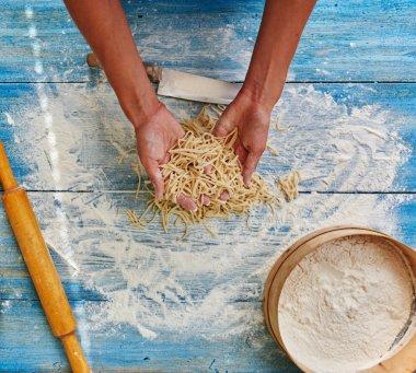 Cook woman preparing Italian pasta