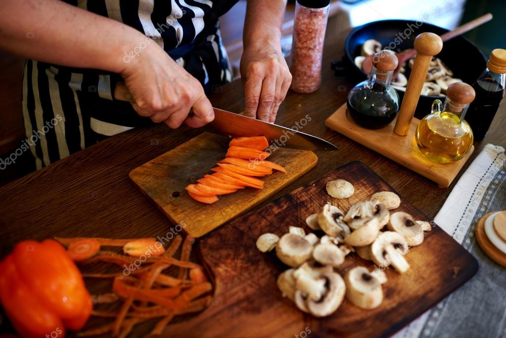 Cook chopped fresh vegetables for dinner