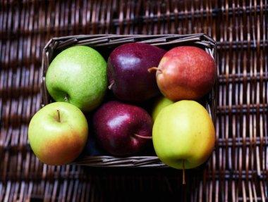 Apples lie in a wicker box