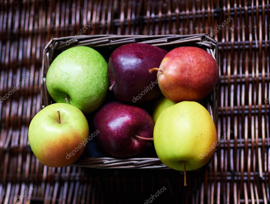 Apples lie in a wicker box
