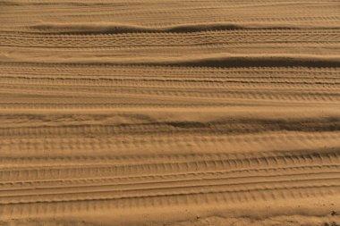 Tires tracks on sand.