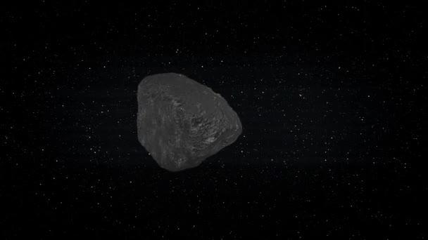 Meteorit se vznáší ve vesmíru s hvězdami