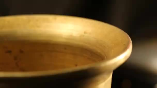 Dropping Seeds into a Spice Grinder