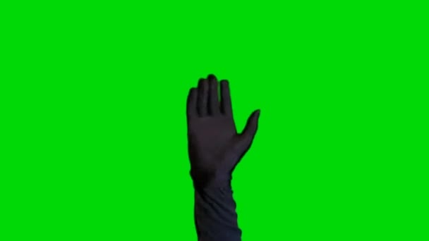 Ruce ve vzduchu na pozadí zelené obrazovky
