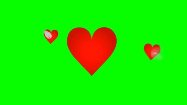 Šťastný den matek velké červené srdce a dvě srdíčka na pozadí zelené obrazovky
