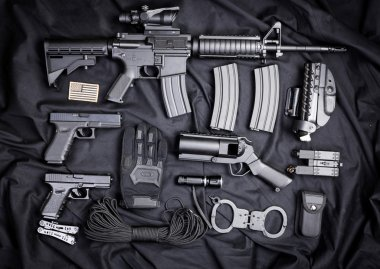 set of guns on black cloth