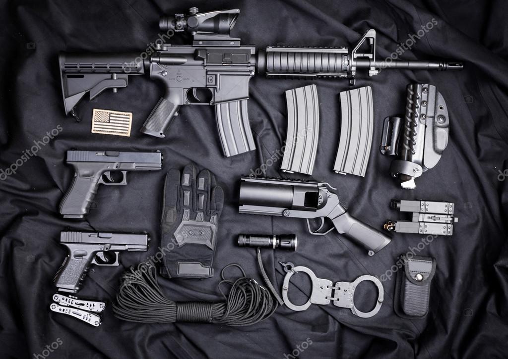 set of guns on black cloth