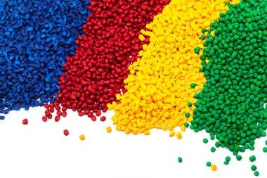 heaps of spectrum colored tinted plastic granulates