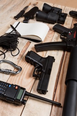 guns on wooden desk