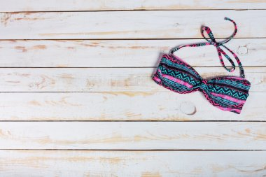 swimsuit on wooden background