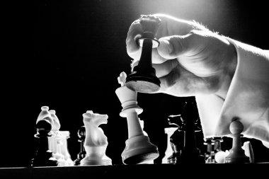 hand playing chess