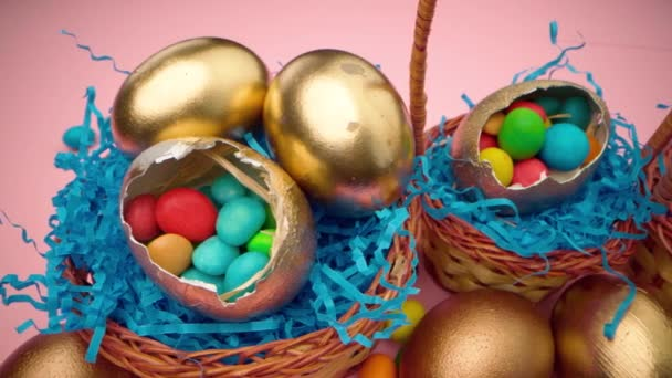 Easter egg with colorful candies in a basket close up