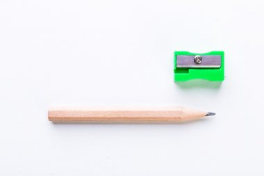 yellow pencil and green pencil sharpener
