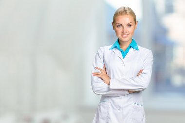 smiling blonde doctor woman