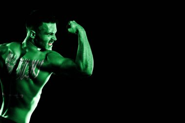 Saudi Arabia flag on handsome young muscular man black background