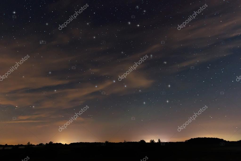 Beautiful night sky, with clouds and constellations, Hercules, Draco, Ursa Major, Ursa Minor, Big Dipper, Botes