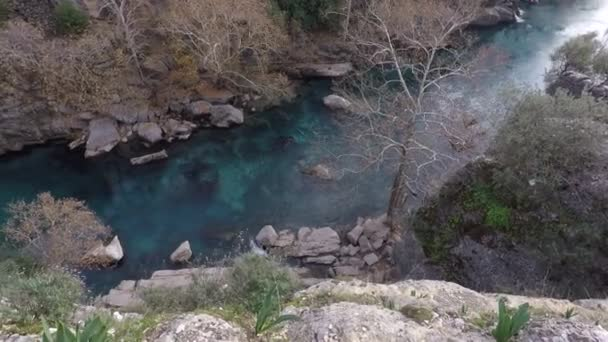 the stone gorge flows a river with clear mountain water