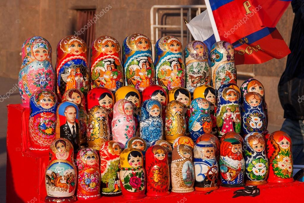 MOSCOW, RUSSIA - March 31, 2008. Russian traditional nested dolls - matryoshka. Some dolls have a portrait of V. V. Putin, the Russian president. Dolls are on sale as souvenirs for tourists.