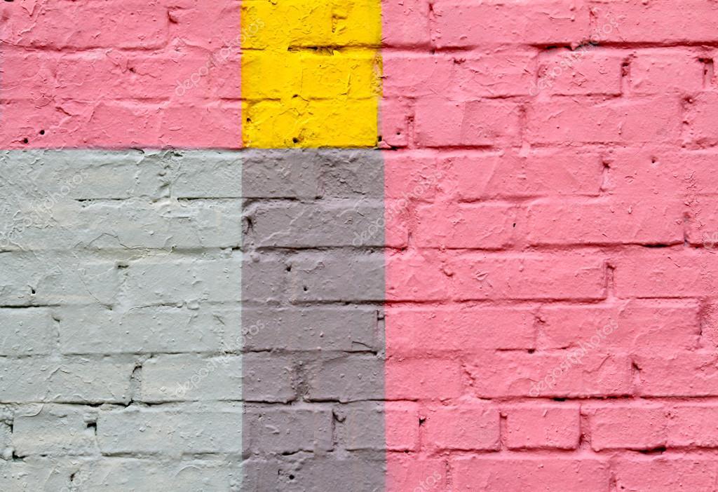 Pared de ladrillos de colores rosa amarillo azul y gris for Gris verdoso pared