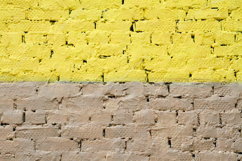 Colorful (yellow and beige) brick wall as background, texture ...