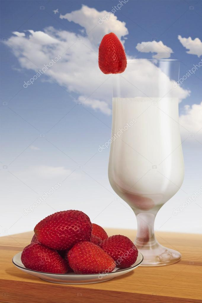 Plateful Of Strawberries With Glass Of Milk
