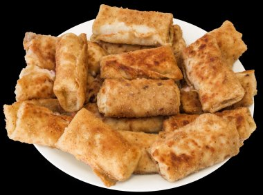Plateful of Breaded Cheese and Ham Pancake Rolls, Isolated on Black Background