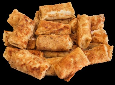 Bunch of Breaded Cheese and Ham Pancake Rolls Isolated on Black Background