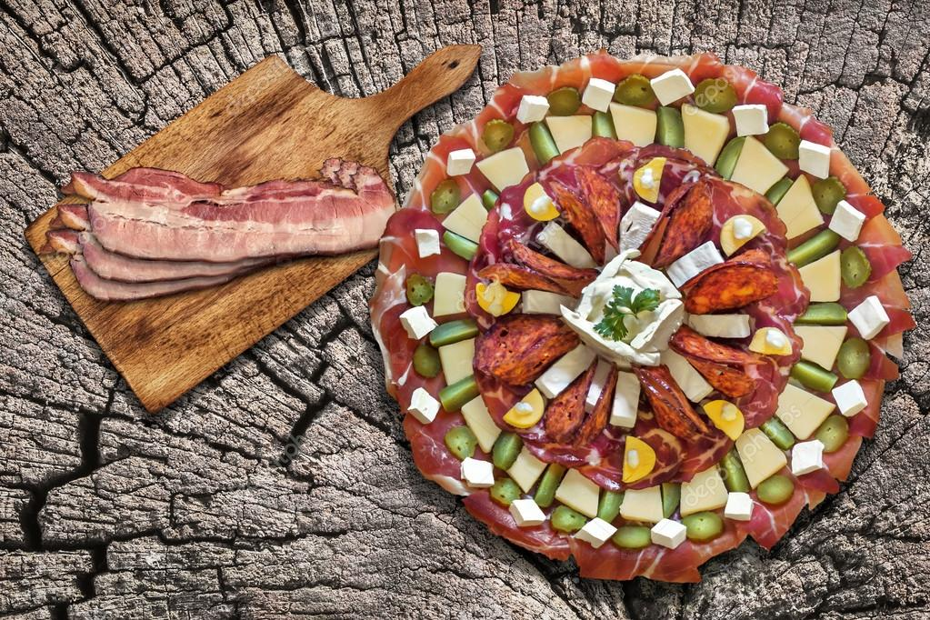 Appetizer Savory Dish Meze with Bacon Rashers on Old Wood Background