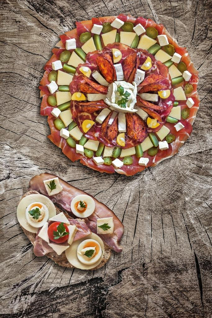 Appetizer Savory Dish Meze with Bacon Cheese Egg Sandwich on Old Wood Background