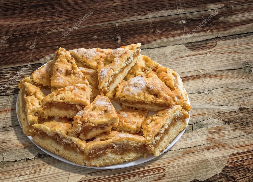 Plateful of Lazy Apple Pie Slices on Old Cracked Peeled Wood Background
