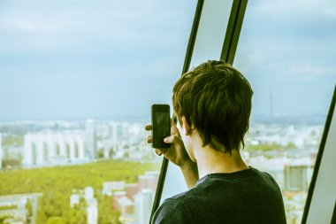 man takes photo