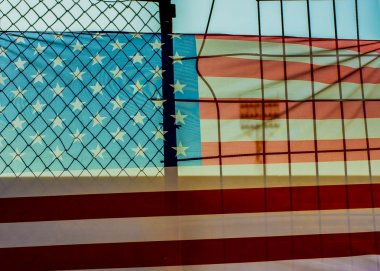 American flag behind fence